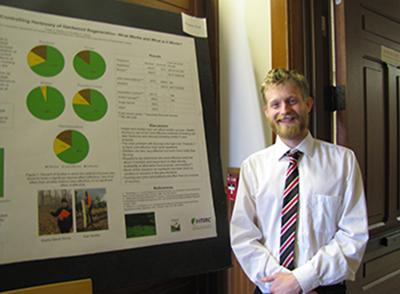 Caleb Redick with poster
